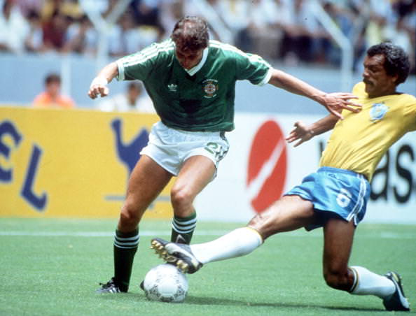 1986 World Cup Finals, Guadalajara, Mexico, 12th June, 1986, Brazil 3 v Northern Ireland 0, Northern Ireland's David Campbell is tackled by Brazil's Junior
